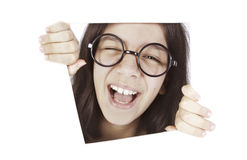 Happy teenager girl is smiling in the window Royalty Free Stock Photography