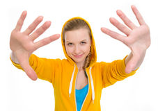 Happy teenager girl stretching palms in camera Royalty Free Stock Photography