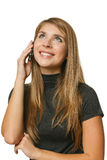 Teenager girl talking on mobile phone and looking up Stock Image