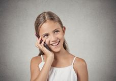 Happy teenager girl talking on smartphone Royalty Free Stock Image