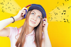Happy teenager girl uses a headphones stock photo