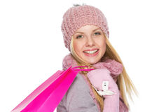 Happy teenager girl in winter hat and scarf with shopping bag. Portrait of happy teenager girl in winter hat and scarf with shopping bag Royalty Free Stock Photography