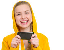 Happy teenager girl writing sms Royalty Free Stock Image