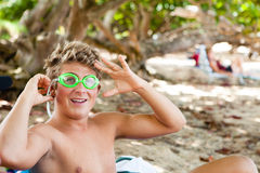 Happy teenager in Hawaii. Athletic teenager getting ready to swim while on vacation Royalty Free Stock Photos