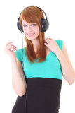 Happy teenager with headphones in dress Royalty Free Stock Photography