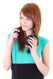 Happy teenager with headphones in dress Stock Photos