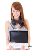Happy teenager with headphones and laptop Stock Photos