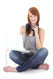 Happy teenager with headphones and laptop sitting Stock Photo