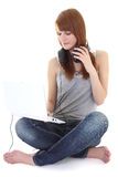 Happy teenager with headphones and laptop sitting Stock Images