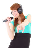 Happy teenager with headphones and microphone Royalty Free Stock Images