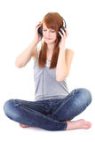 Happy teenager with headphones sitting Royalty Free Stock Photos