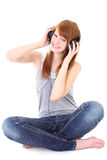 Happy teenager with headphones sitting Stock Photo