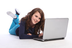 Happy teenager high school girl on internet Stock Image