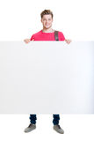 Happy teenager holding a blank banner isolated on white Royalty Free Stock Photos
