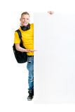 Happy teenager holding a blank banner isolated on white Stock Photos
