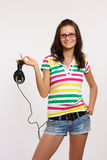Happy Teenager Holding Headphone Stock Photography