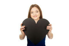 Happy teenager holding paper heart. Stock Photo