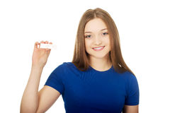 Happy teenager holding pregnancy test. Stock Photography