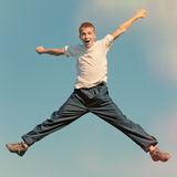 Happy Teenager jumping Stock Photos