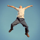 Happy Teenager jumping Stock Images