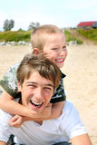 Happy teenager and kid Stock Photography