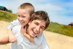 Happy teenager and kid. On the beach Royalty Free Stock Photos