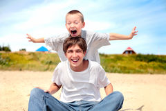 Happy teenager and kid Royalty Free Stock Photography