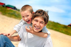 Happy teenager and kid Royalty Free Stock Photo