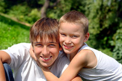 Happy teenager and kid. Portrait outdoor Stock Image