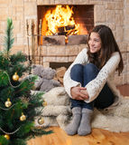 Happy teenager kid near christmas tree Stock Photo