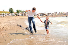Happy teenager and kid running Royalty Free Stock Photos