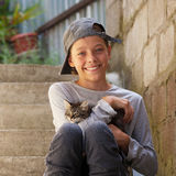 Happy teenager with kitten Stock Photography