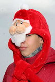 Teenager in a cap of Father Frost (Santa Claus) Royalty Free Stock Photography
