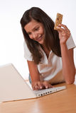 Happy teenager with laptop holding protein bar Royalty Free Stock Photos
