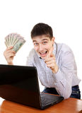 Happy Teenager with Laptop and Money. Pointing at You on the White Background Stock Images