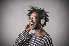 Happy teenager listening to music Stock Photos