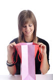 Happy teenager looking in her shopping bag Stock Image