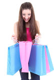 Happy teenager looking into shopping bags Royalty Free Stock Images