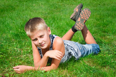 Happy teenager lying on the grass Royalty Free Stock Photo