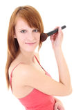 Happy teenager with make-up brush Royalty Free Stock Photo