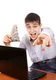 Happy Teenager with a Money. Happy Teenager with Laptop and Money pointing at You on the White Background Royalty Free Stock Photos