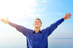 Happy Teenager outdoor. Happy Teenager with Hands Up on the Sea background Stock Photos