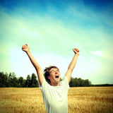 Happy Teenager outdoor. Toned photo of Happy Teenager in the Wheat Field Stock Photos
