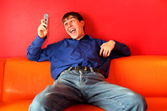 Happy teenager with phone. Teenager get funny sms on the phone Stock Photos