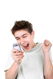 Happy teenager with phone Stock Photography