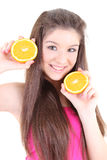 Happy teenager in pink with half of oranges Stock Photos