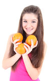 Happy teenager in pink with oranges Royalty Free Stock Photography