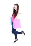 Happy teenager in pink t-shirt with shopping bags Stock Images