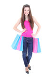Happy teenager in pink t-shirt with shopping bags Royalty Free Stock Photography