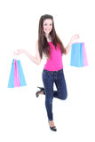 Happy teenager in pink t-shirt with shopping bags Royalty Free Stock Photos